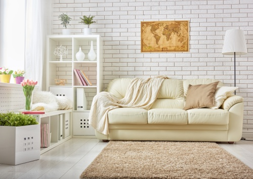 a bright room with white brick walls, shades of white, and pops of color
